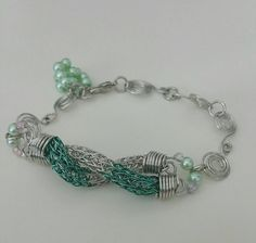 Check out this item in my Etsy shop https://www.etsy.com/listing/225214283/ladies-braceletshand-woven-viking-knit