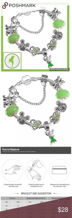 """Disney Tinkerbell & Friends Charm Bracelet Beautiful Disney Charms incl Minnie w/ green zirconia, crystal/glass & Mickey on a Tension Mounted """"Snake chain"""" bracelet Plated in 925 Silver, has a hidden safety clasp-perfect for the young ones!   Completely Environmentally friendly, both Lead & Nickel free as well as Allergy-Free. See Maintenance Info above. Size 20 mm+. Will fit most wrists. The more charms added the longer the bracelet, See Sizing Guide as reference  Pair with Zirconia Mickey…"""