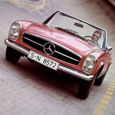 Can you think of any car that is more elegant and perfectly shaped than the Mercedes-Benz SL from the 113 series? Mercedes Auto, Mercedes 230, Mercedes Benz Autos, Classic Mercedes, Daimler Benz, Daimler Ag, Land Rover Defender, Motor Car, Cool Cars