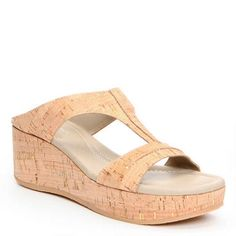 e31fe06258079b Cut-out detailing accents these easy slip-on wedge sandals. Detailed with  cool