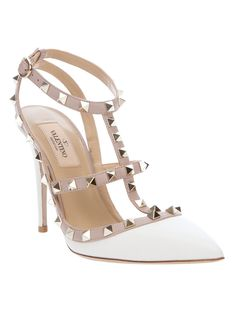 valentino - simple and elegant.  Love this shoe...I should clean shoes for a living...I've really taken a shine to it. :)