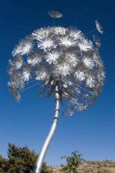 Steel & aluminum blowing Dandelion sculpture. 15 feet tall. Awesome!