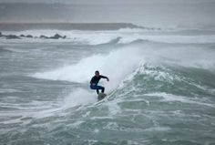 A surfer rides a wave at Costa da Caparica beach in Almada, outside Lisbon. Portugal is popular with bodyboarders and surfers, specially during the winter months when big swells hit its Atlantic coast. | The Windsor Star