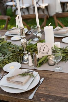 Rustic Place Setting with Garland & Candles | Photography: Stacy Newgent. Read More: http://www.insideweddings.com/weddings/rustic-barn-wedding-tented-reception-on-family-farm-in-ohio/690/