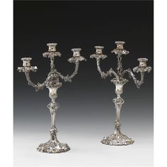 A PAIR OF SILVER-PLATED THREE-LIGHT CANDELABRAS, ELKINGTON, SHEFFIELD, CIRCA 1900