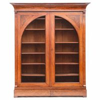 Mahogany Biedermeier 2 doors bookcase.  The doors arc shaped and with wire mesh. With 2 drawers.Dutch, early 19th century. H 255x210x55 cm.