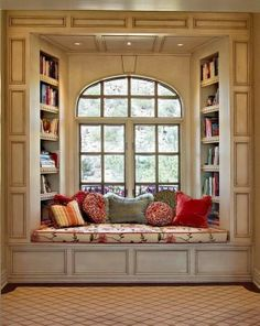 I've always wanted a cozy window seat like this!