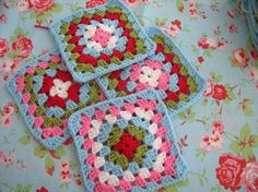 Granny Squares purposely coordinated with wallpaper or special fabric. I like it!