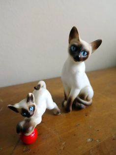 Two miniature vintage bone China Siamese cat figurines on Etsy, $49.00