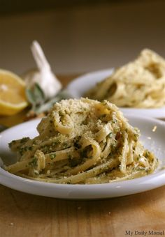 Fettuccine with Sage and Asiago Pesto: 1 cup fresh sage leaves  1/4 cup walnuts  2 cloves garlic, peeled  1 teaspoon kosher salt  1/2 teaspoon freshly ground black pepper  1/3 cup extra-virgin olive oil  1 cup grated Asiago cheese  1 lb fettuccine pasta  1 lemon, juiced