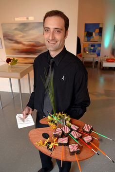 Credit: labonnecuisine.com  Catering presentation idea, served on a palette, with paintbrushes. They also had a ornate picture frames and a watercolor box. At my own wedding, I used this palette idea.