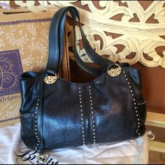 Brighton handbag Metallic Blue Brighton handbag, from the Brighton Outlet,  great purse, 2 compartments and also has pockets on the sides, the straps do show wear, see last photo. Brighton Bags Shoulder Bags