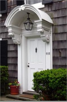 Sweet portico make this doorway welcoming to all!