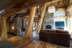 This showstopper of a home features complex leaning logs, amazing views of the valley, and a high-end kitchen.