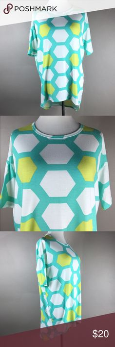 """XXS LuLaRoe Irma Tee---fits up to a medium or lg! Very roomy fit, Crew neck, short sleeves, hi low hemline, longer tunic style length.  Soft and lightweight 96% spun polyester/4% spandex.  Bust 23"""", length 28-32"""".  In excellent condition without fading, frays or snags! LuLaRoe Tops"""