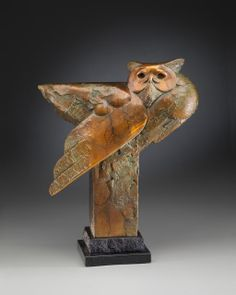 """""""Forest Ghost"""" Wildlife Sculpture of a Great Horned Owl by Tim Cherry  16"""" x 13"""" x 6"""" bronze ed/18    Available through Columbine Gallery"""