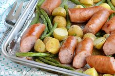 This Sheet Pan Smoked Sausage Dinner with potatoes and green beans is super easy to make, takes just 25 minutes to bake and is definitely kid approved!