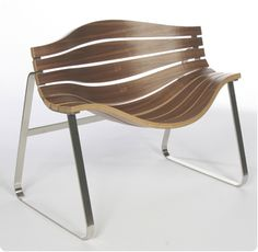 The Streamline Chair is a sleek modern armchair was designed by Singapore-based industrial design studio Jarrod Lim Design.  This modern chair can be used both  indoors and out. The simple curved forms that give the chair its  distinctive shape provide a comfortable seating platform but one that is  visually lightweight and aesthetically pleasing.