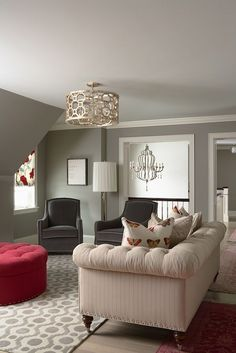 BM Owl Gray Chic living room design with pigeon gray walls paint color, light gray painted ceiling, charcoal gray velvet curvy accent chairs, ivory tufted chesterfield sofa, round red tufted storage ottoman, octagon drum pendant chandelier and ivory & gray fretwork rug. Love the rug, lamp, wall