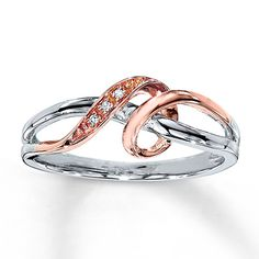 Brilliant round diamonds accent the center of this pretty diamond ring for her. A twist of rose gold swirls around the sterling silver band for added appeal. Pearl Jewelry, Jewelry Rings, Jewelery, Fine Jewelry, Gold Jewellery, Jewelry Box, Sterling Silver Diamond Rings, Diamond Gemstone, Engagement Ring Shapes
