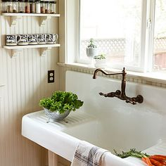 "Feature farmhouse functional This reproduction sink has slightly tilted drainage boards, ""which are almost like having counter space."""