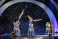 Cirque de Soleil lights up the stage with an electrifying performance during #AGT's second night of live shows. / America's Got Talent