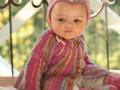 DROPS jacket knitted from side to side, socks and hat in Fabel. Free pattern by DROPS Design.