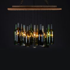 Wine Bottle Chandelier Rough, reclaimed wood is the ideal contrast against spectacular illumination, and this Wine Bottle Chandelier combines the two worlds. Reclaimed wood and reclaimed wine bottles create a warm, winning duo of design, which will add a playful element above any table or countertop.