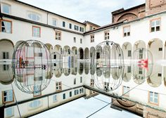 Milanese cloister covered with mirrors for exhibition of Danish design.