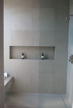Neutral matte grey large scale tiles inspired by concrete for a modern bathroom ideas kitchens bathrooms . Tile Shower Shelf, Large Tile Bathroom, Recessed Shower Shelf, Fitted Bathroom, Concrete Bathroom, Shower Niche, Modern Bathroom, Master Bathroom, Bathroom Shelves