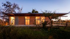 oriented to maximize natural light, the dwelling is surrounded by acacia trees that provide shade throughout the day.
