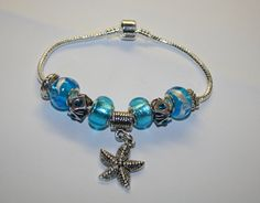 Teal Beaded Starfish Charm Bracelet by TheSisters3Boutique on Etsy, $17.99