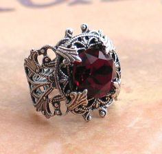 Stunning Vintage Garnet Jewel and Silver Filigree Ring -  by Lorelei Designs. $49.00, via Etsy.