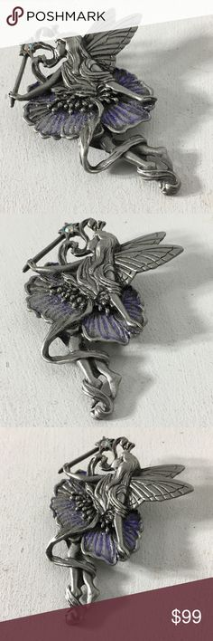 """Vintage JJ Jonette Signed Fairy 🧚🏽♀️ Brooch/Pin Fashion/Costume Brooch.  Metal/Stones Unknown. Years of purchased jewelry which has a history that I am unaware of so if you have allergies, keep that in mind. Always clean purchased jewelry.  Please ask all questions before purchasing. Good Used Condition - fading/discoloration of metal.  Sold """"As Is"""".  Shows wear which is consistent with its age. Please remember, the pictures are your description, too, so please look at all of them…"""