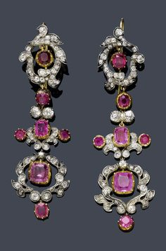 A PAIR OF ANTIQUE RUBY, SAPPHIRE AND DIAMOND EAR PENDANTS, CIRCA 1880. Very decorative long ear pendants, each of articulated floral and foliate design, set with diamonds, rubies and pink sapphires, mounted in silver and gold. #antique #earrings