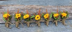 Mini sunflower boutonnieres with stem wrapped in twine