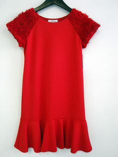 """Louis and Norma Di Paolo crafted a classic yet timely fall line of special occasion pieces. A favorite for fall is the Audrey Hepburn-esque dress in """"look-at-me"""" red with textural details at the shoulders. www.alessiaclothing.com (editor's pick)"""