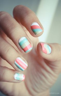 Unexpected pastels are what make a simple striped manicure like this really striking.    Pro tip: to make these nails truly easy, use scotch tape as guides to keep your lines perfectly straight and clean.