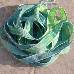 Splash Silk Ribbons Hand Dyed Jewelry String Watercolor Blues Green Yellows. $24.99, via Etsy.
