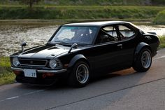 Toyota was the BIZness in the 70's.. Case in Point in this super badass flared TE27 Levin Corolla in Jet Black on a massive wide set of RS Watanabes soaking the autumn air..