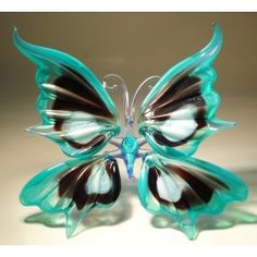 Blue, Black and White Glass Butterfly $26.95 http://www.glasslilies.com/161-blue-black-and-white-glass-butterfly.html #Blue #Black #White #Glass #Butterfly #GlassArt #Gifts #BlownGlass #Figurine