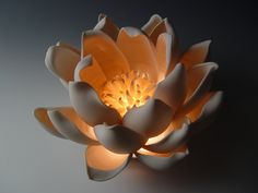 """Tulip"""" Ceramic Table Lamp Created by Lilach Lotan Ceramic lighting centerpiece in wheel-thrown and hand-built unglazed translucent porcelain. Uses one 10 watt halogen bulb (included). Flower Lamp, Lotus Flower, Ceramic Light, Cool Lamps, Ceramic Table Lamps, Ceramic Decor, Ceramic Art, 3d Prints, Ceramic Flowers"""
