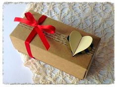Simple kraft box embellished with washi tape and a stitched heart.