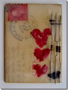 encaustic collage--don't love the red hearts, but like the postcard image buried under layers of encaustic!