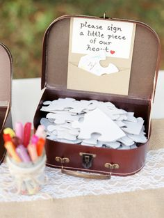 Puzzle piece guestbook: http://www.stylemepretty.com/collection/4306/