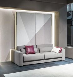 """Two become one . . . becomes two! Ella & Louis is a """"Queen-Plus""""-size wall bed with an integrated sofa — but press the hidden release button and watch the Ella & Louis divide into two separate single-sized beds with integrated armchairs. This hyper-flexible system is completely self-standing, so it can be installed virtually anywhere. Ella & Louis is an ideal space solution for vacation homes, guest rooms, or short term rentals where a variety of sleeping arrangements is needed. Twin Wall Bed, Bed Wall, Home Room Design, Bed Design, Hidden Wall Bed, Resource Furniture, Modern Murphy Beds, Small Home Offices, Guest Room Office"""