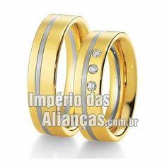 Aliança de noivado e casamento em ouro amarelo e ouro branco 18k Largura 5.5mm Pedras 3 diamantes de 2 pontos Acabamento Fosco e Liso Formato Anatômico Peso 13,50 gramas O PAR