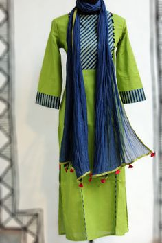 an elegant kurta in fresh spring green linen-cotton blend that has an ajrakh (indigo) striped yoke with potli buttons to compliment the colour! the striped yo Salwar Pattern, Kurti Patterns, Salwar Designs, Blouse Designs, Dress Designs, Indian Attire, Indian Wear, Pakistani Outfits, Indian Outfits