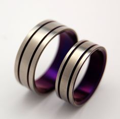 Alma Mater - Purple Titanium Wedding Band Set. $300,00, via Etsy. Maybe my BF would like these.