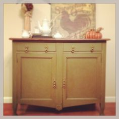 This is Olive Chalk Paint® decorative paint by Annie Sloan.  There is a coat of clear and dark wax.  I had African Bronze Gilding wax and added that to the hardware.  This cabinet came with no top so we added one in Walnut!  Love this piece!